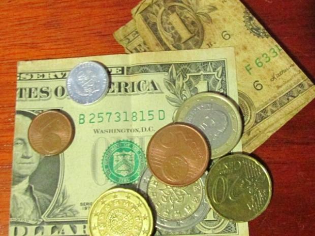 moedas euro dólar a bussola quebrada